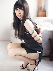 Yuko Asian in heels and cute dress has hands tied of her boobs